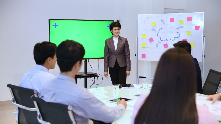 Business concept. Women are presenting work at the meeting. 4k Resolution. | Shutterstock HD Video #1035537548