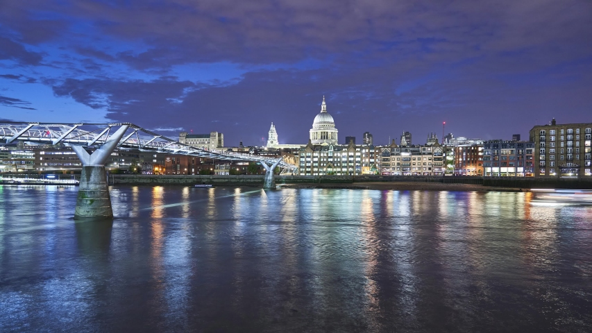 London night timelapse across the Thames river with the Millenium Bridge and St Pauls cathedral. England, UK | Shutterstock HD Video #1035589208