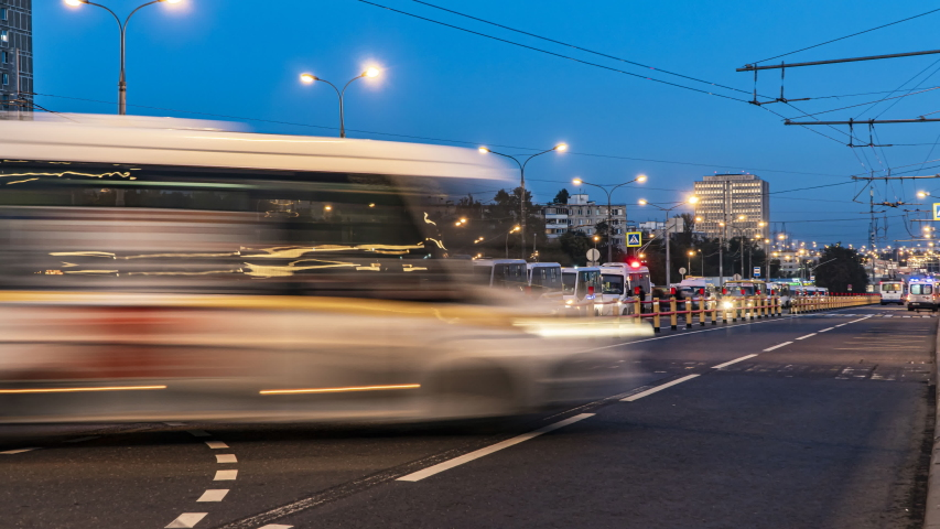 Bus traffic at the city bus terminal, time lapse | Shutterstock HD Video #1035635648