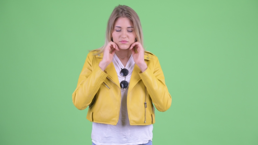 Stressed young rebellious blonde woman having headache | Shutterstock HD Video #1035920048