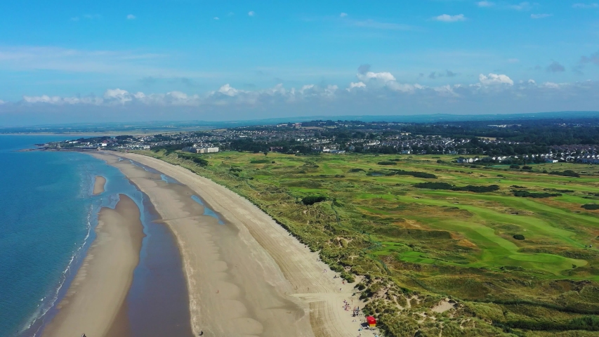Aerial drone view of Portmarnock beach and golf course on a beautiful summer day on the irish coast.Portmarnock, Dublin county, Ireland, 8 August 2019 | Shutterstock HD Video #1036034438