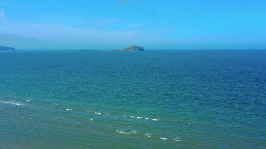 Ireland eye island viewed from Dublin coastline. Aerial beach drone view  | Shutterstock HD Video #1036045748