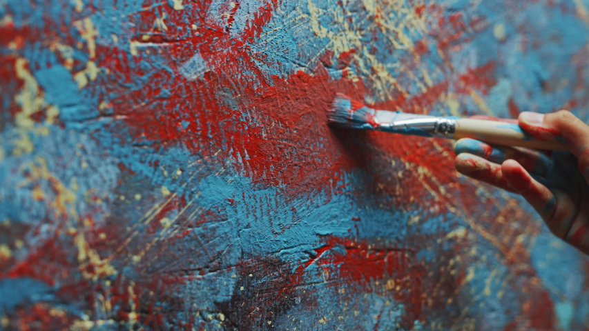 Close-up Shot of Female Artist Hand, Holding Paint Brush and Drawing Painting with Red Paint. Colorful, Emotional Oil Painting. Contemporary Painter Creating Modern Abstract Piece of Fine Art | Shutterstock HD Video #1036107788