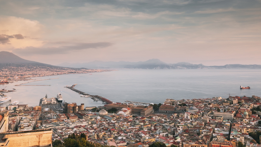 Naples, Italy. Top View Skyline Cityscape In Evening Lighting. Tyrrhenian Sea And Landscape With Volcano Mount Vesuvius. City During Sunset And Night Illuminations. Day To Night Transition | Shutterstock HD Video #1036329758