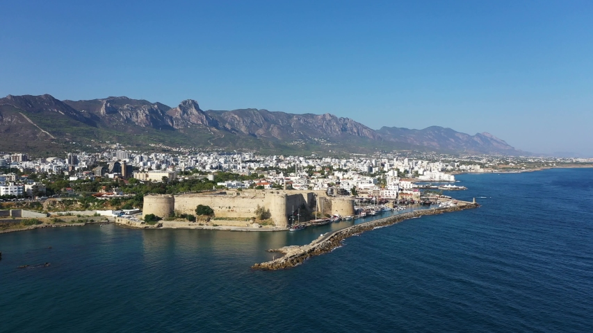 Kyrenia (Girne) is a city on the north coast of Cyprus, known for its cobblestoned old town and horseshoe-shaped harbor. | Shutterstock HD Video #1036395368