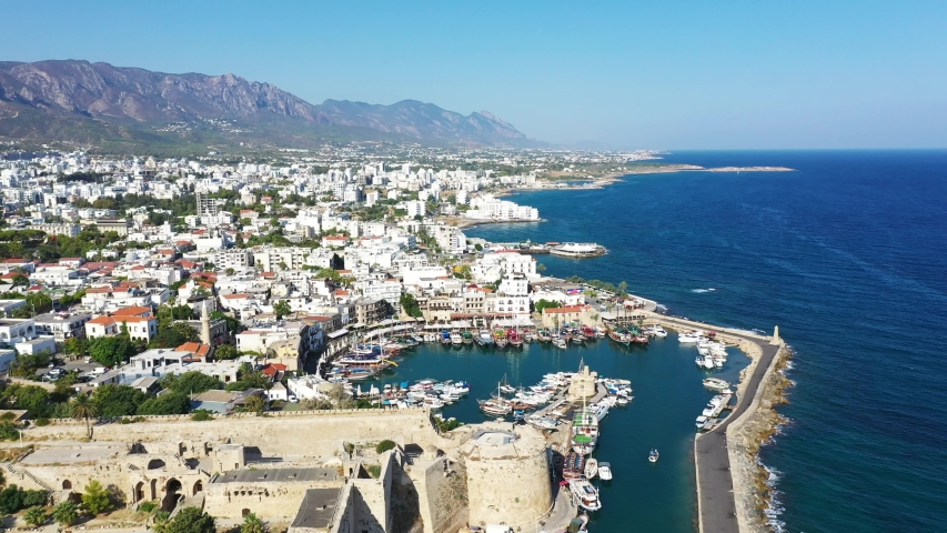 Kyrenia (Girne) is a city on the north coast of Cyprus, known for its cobblestoned old town and horseshoe-shaped harbor. | Shutterstock HD Video #1036395398