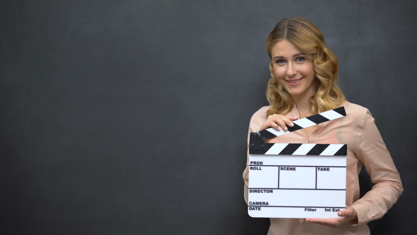 Beautiful girl using clapperboard, advertise of acting school, film production | Shutterstock HD Video #1036590278