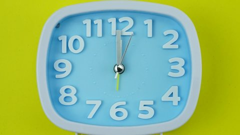 Closeup Zoom out Twelve o'clock Blue clock face beginning of time 12.00 Eat lunch, Time lapse 60 minutes moving fast.