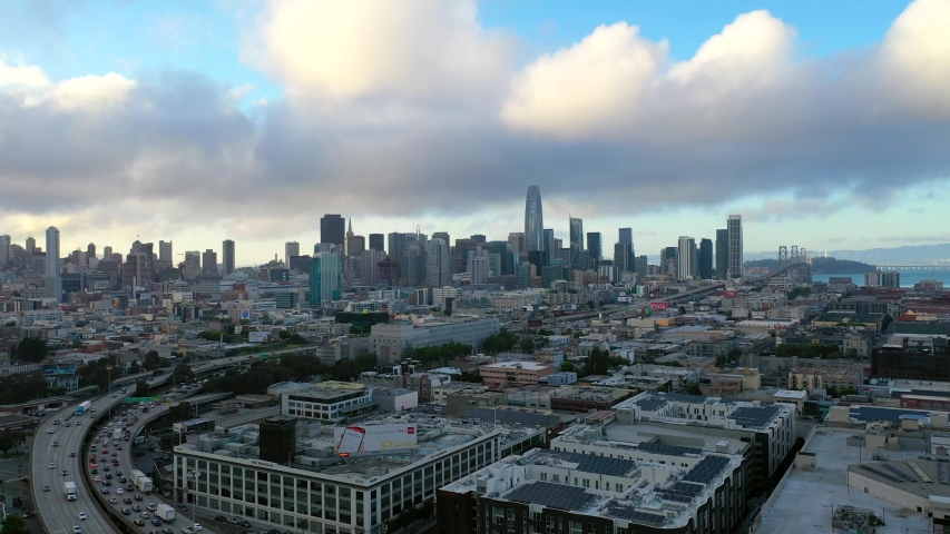San Francisco skyline drone clip from South of Market (SOMA) with highway 101 and and Bay Bridge visible
