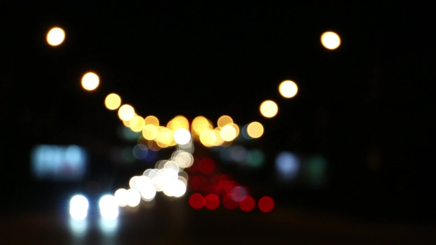 Blurred car lights at the crossroads of the big night city   Shutterstock HD Video #1036901198