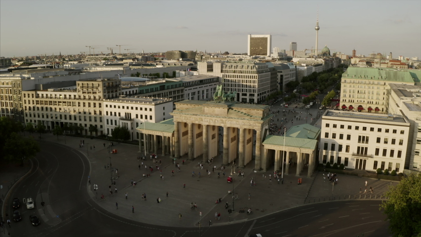 Berlin. The drone starts at the Brandenburg gate (Brandenburger Tor) and is revealing the skyline including the TV tower, the Bundestag, the Tierpark and many sights of the capital of Germany.