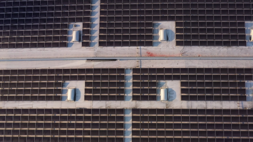 Aerial shot of solar panels covers the roof of a large building   Shutterstock HD Video #1037047808