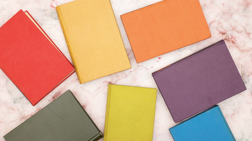 Colorful books move from the middle and make frame for your title - Stop motion  | Shutterstock HD Video #1037091458