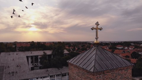 Sunset Church cross in the suburb aerial