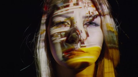Close up shot of projections on stressed woman's face