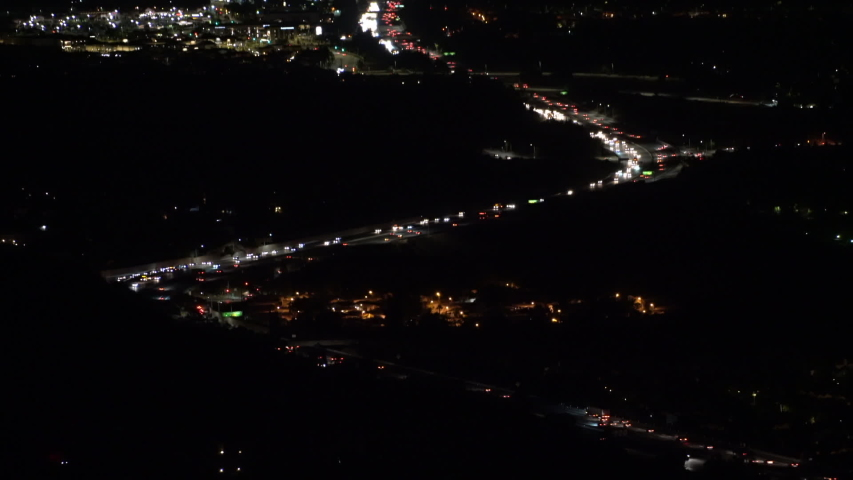 Mountaintop view of moving headlights on route 118 freeway in the San Fernando Valley area of Los Angeles. | Shutterstock HD Video #1037217158