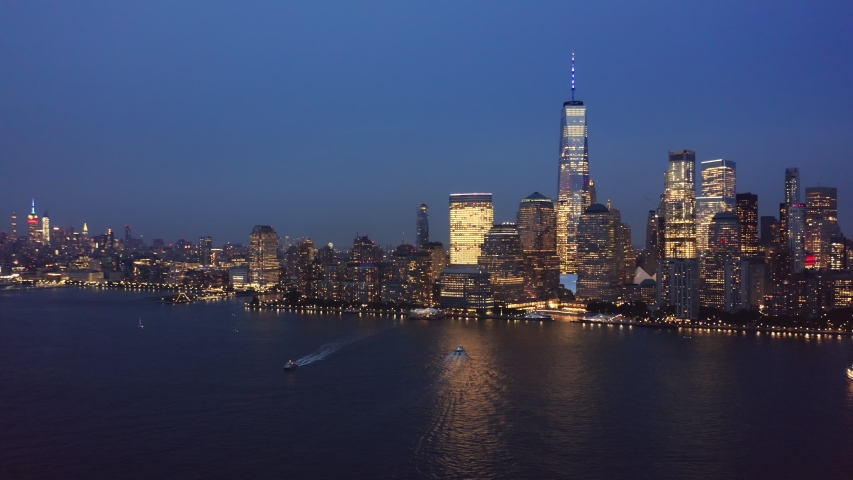Drone footage with slow rotation in front of New York City skyline on September 11. | Shutterstock HD Video #1037228888