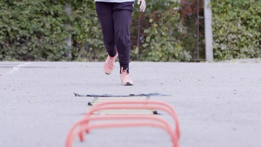 Elementary school gym class outdoors. Close up of kids feet on the obstacle course | Shutterstock HD Video #1037265098