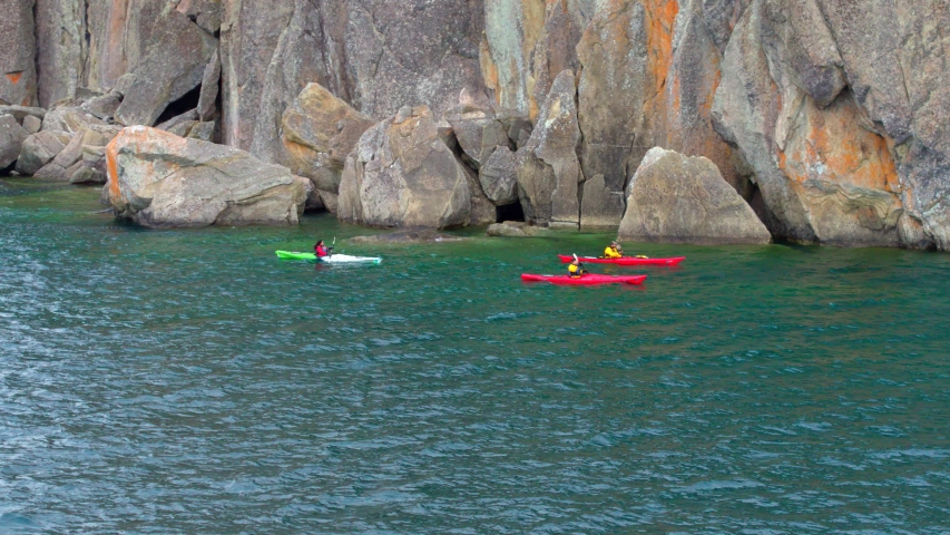 Kayaking Through Rocky Water, Cliffs, Aerial Drone | Shutterstock HD Video #1037304428
