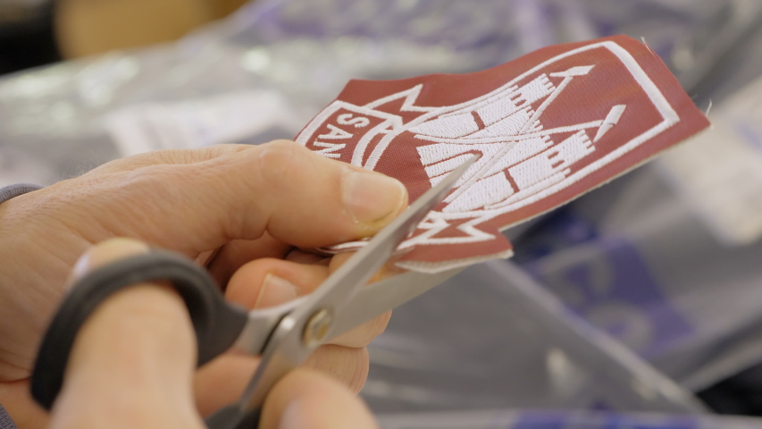Hands cutting fabric patches.Profession, sewer, creativity | Shutterstock HD Video #1037327798