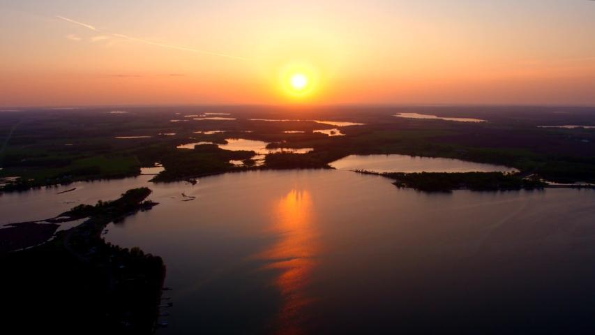 Beautiful Rural Wetlands at Sunset, 4K Aerial Drone Shot | Shutterstock HD Video #1037358308