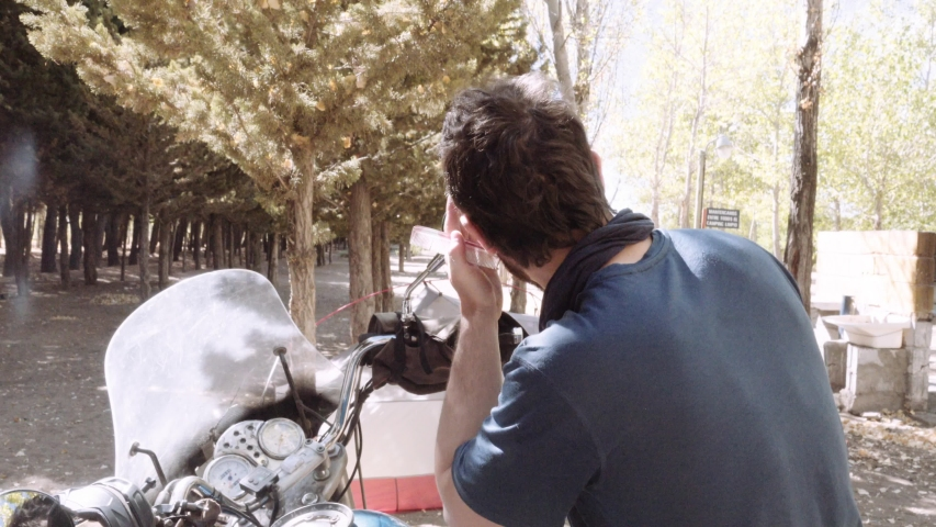 Man cuts his own hair short   Shutterstock HD Video #1037362358