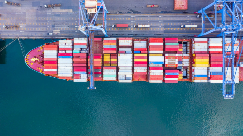 4k, Aerial view time lapse container ship carrying container in import export business logistic and transportation of international by container ship in the open sea.   Shutterstock HD Video #1037382728