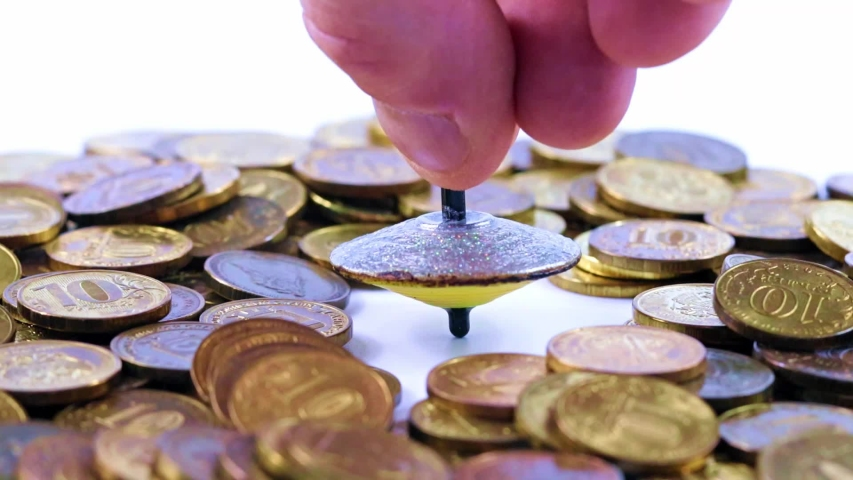Plastic spinning top and metal coins   Shutterstock HD Video #1037415548