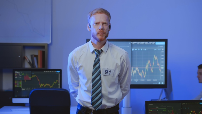Young financial trader monitoring stock growth and excited about successful investment | Shutterstock HD Video #1037417978