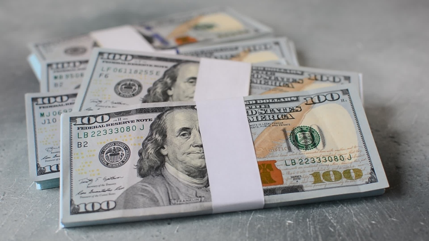 Stack of USA dollars money fall on the table   Shutterstock HD Video #1037495498