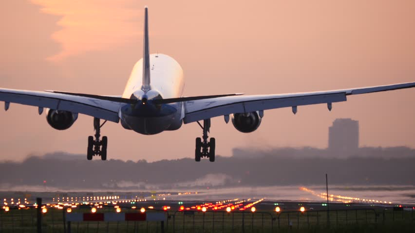 4K Airplane landing at dusk | Shutterstock HD Video #10374956