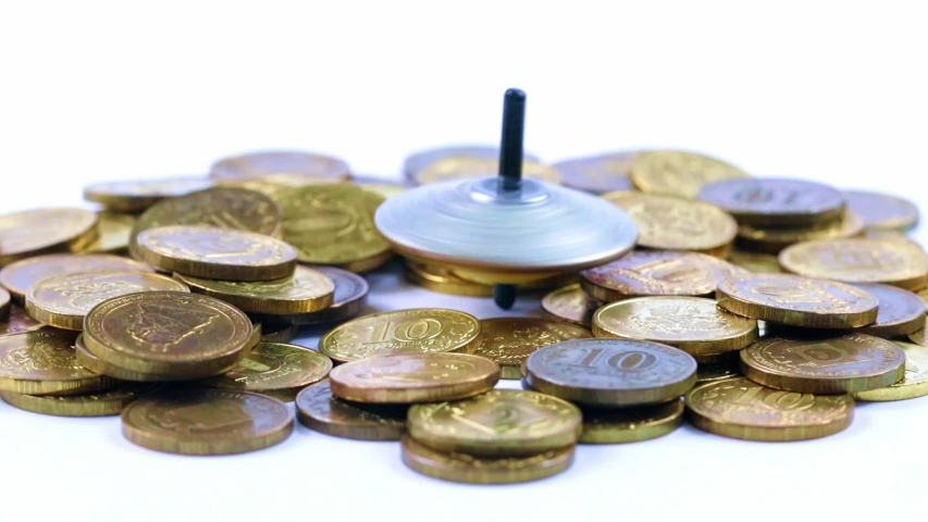 Plastic spinning top and metal coins   Shutterstock HD Video #1037498078