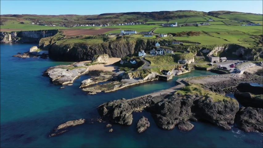 Ballintoy harbour on the Co. Antrim coast of N. Ireland and Game of Thrones filming location, drone view.   Shutterstock HD Video #1037528678