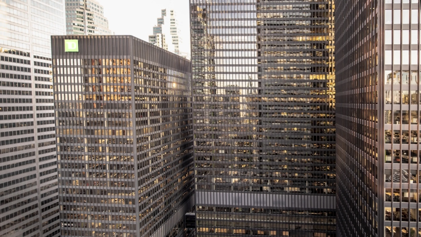 Wide timelapse of skyscraper windows at sunset. Time lapse of day to night transition on modern office building in downtown Toronto. Business people working overtime late at night at their desk. | Shutterstock HD Video #1038013718