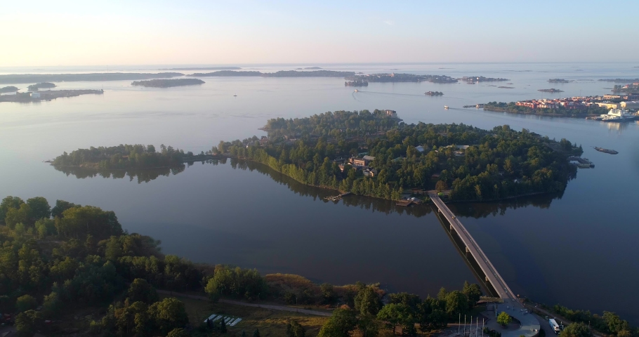 Korkeasaari zoo island, Aerial, static, drone shot, of a animal park, on a isle, on a sunny and misty autumn morning dawn, in Helsinki, Uusimaa, Finland | Shutterstock HD Video #1038171968