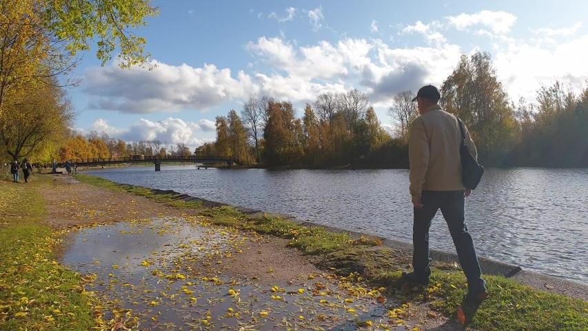 A man walks in the fall. Lonely man in autumn | Shutterstock HD Video #1038248408