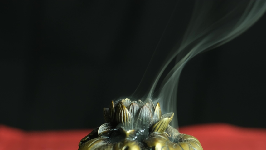 Abstract footage of a smoke. Smoke rising over natural, wood background. Insence burner. sandalwood, aroma ceremony. Incense preparation. Aromatherapy. China, Japan. Art smoke. Spiritual practices. | Shutterstock HD Video #1038304478