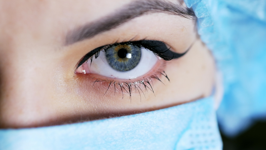 Extreme close-up of woman's surgeon eye, doctor looking at camera, medicine concept. | Shutterstock HD Video #1038762158