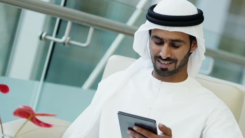 Business male businessman Arab UAE technology tablet hotel trading markets