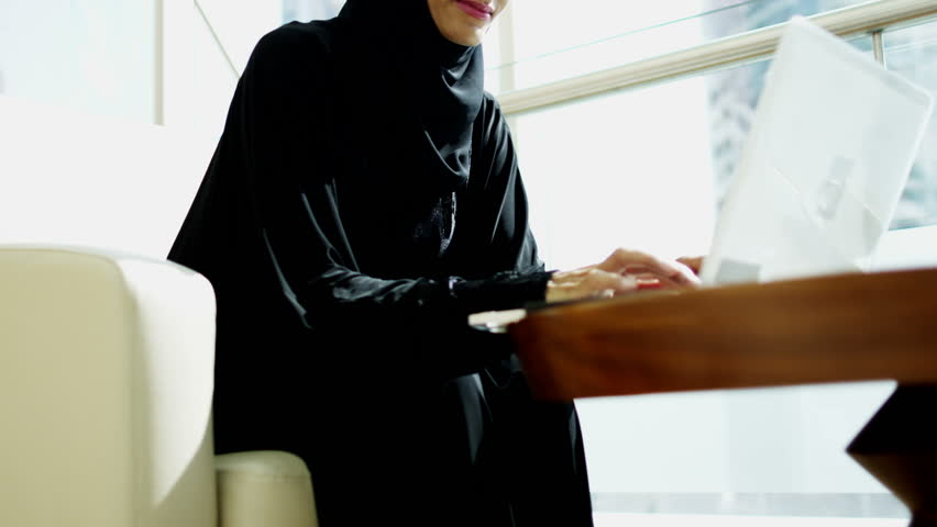 Arab businesswoman global hotel travel investment smart phone laptop technology