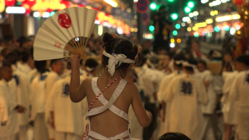 KYOTO, JAPAN - 17 JULY 2019 : Scenery of GION MATSURI (FESTIVAL) at night. Famous summer event in Japan. Back shot of unidentified young girl enjoying the festival. | Shutterstock HD Video #1038958958