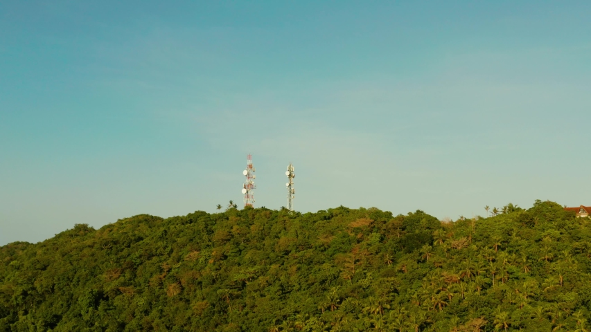 Antennas and microwaves link dishes of mobile phone network and TV transmitter on telecommunication towers. Boracay, Philippines | Shutterstock HD Video #1039011398