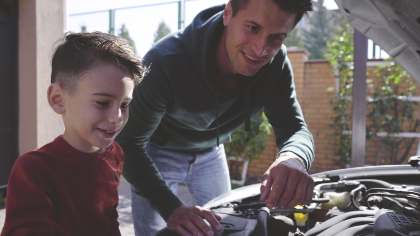 The father and son fixing the car | Shutterstock HD Video #1039130348