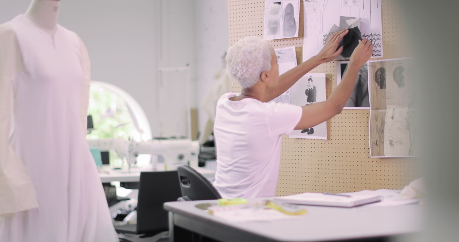 Fashion designer selecting fabrics for designs | Shutterstock HD Video #1039185998