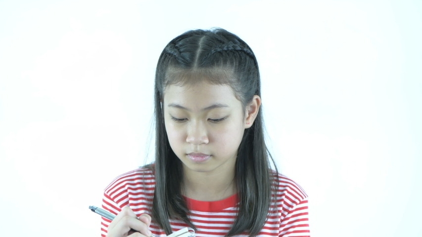 Educational concepts. The girl is taking notes in her notebook on a white background. 4k Resolution.   Shutterstock HD Video #1039197968