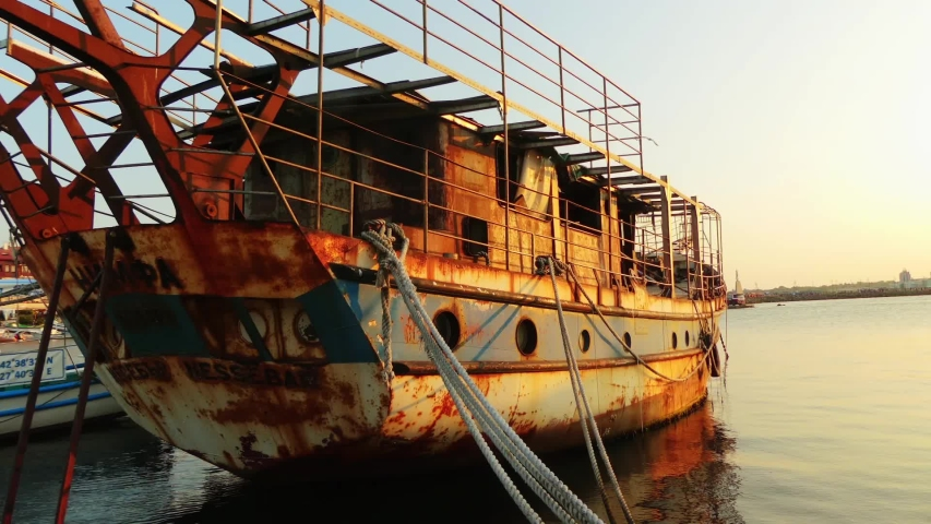 NESSEBAR, BULGARIA - JULY 26 2016: Old rusty ship in the harbor of the town of Nessebar, Bulgaria.