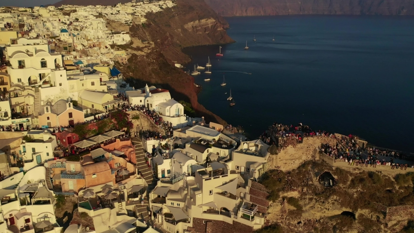 Aerial drone video of iconic village of Oia at sunset with golden colours, Santorini island, Cyclades, Greece | Shutterstock HD Video #1039722338