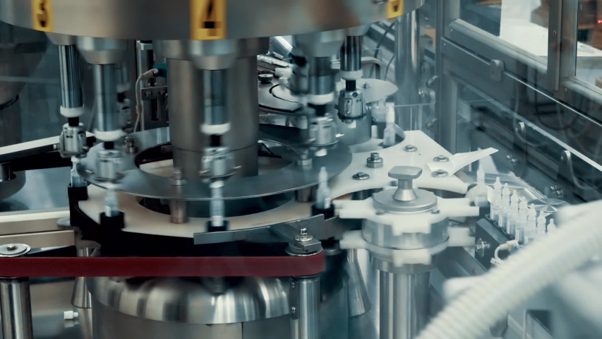 Machine for the production and sorting of a new invented drug in ampoules | Shutterstock HD Video #1039777928