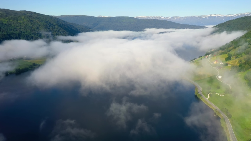 Aerial footage Beautiful Nature Norway over the clouds. #1039778108