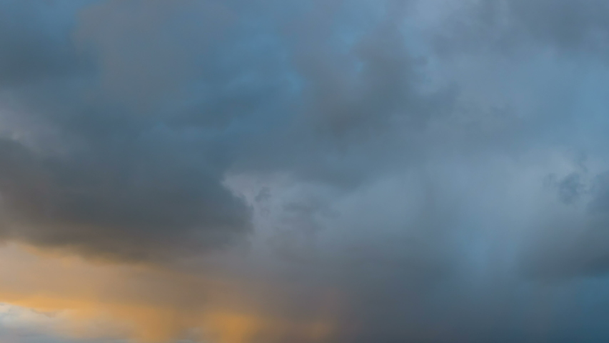 Storm clouds in sky during storm in time lapse as it moves over ocean. Epic storm tropical clouds at sunset. Coast of the Pacific Ocean. Beautiful clouds and sky after sunset 4K UHD Timelapse.   Shutterstock HD Video #1039803098